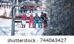people are lifting on ski lift... | Shutterstock . vector #744063427