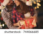 couple with christmas gift ... | Shutterstock . vector #744066685