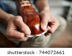 modern cobbler stretching new... | Shutterstock . vector #744072661