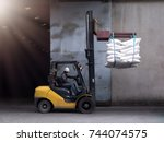forklift handling sugar bags... | Shutterstock . vector #744074575