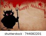 devil with predatory red  eyes... | Shutterstock .eps vector #744082201