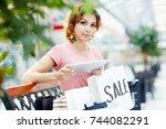 black friday shopper with... | Shutterstock . vector #744082291