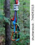 carabiner with rope on nature... | Shutterstock . vector #744092515
