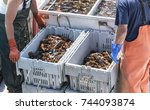 Two Lobster Fishermen Pack Up...