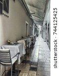 coffe shop in narrow european... | Shutterstock . vector #744125425