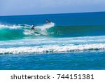 two surfer riding the wave   | Shutterstock . vector #744151381