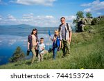 happy family hiking | Shutterstock . vector #744153724