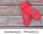 handmade gloves on wooden... | Shutterstock . vector #744160111