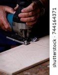 Small photo of Photo of a man working with fret saw