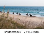 people horseback riding on... | Shutterstock . vector #744187081