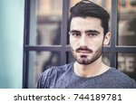 attractive young bearded man... | Shutterstock . vector #744189781
