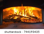 traditional italian pizza wood... | Shutterstock . vector #744193435