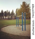 Empty Swing Set At Playground...