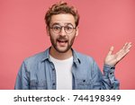 confused bearded man in denim... | Shutterstock . vector #744198349