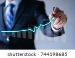 businessman presenting a...   Shutterstock . vector #744198685
