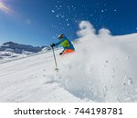 skier skiing downhill during... | Shutterstock . vector #744198781