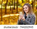 young blond woman in autumn...   Shutterstock . vector #744202945
