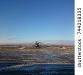 Small photo of Helicopter on an airfield and clear sky