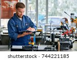 portrait of young worker making ... | Shutterstock . vector #744221185