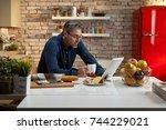 portrait of an older man. older ... | Shutterstock . vector #744229021