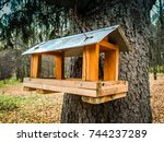 Stock photo wooden bird house contrasting the morning sunlight aged cider wood bird house bird house in the 744237289