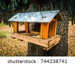 Stock photo house bird bird feeder house birds birds feeder the wood house bird on the tree the wood house 744238741