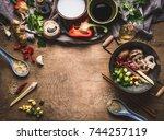 vegetarian stir fry cooking... | Shutterstock . vector #744257119