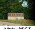 Small photo of TEXOLA, OKLAHOMA--OCTOBER 2017: Oklahoma sign in Texola, border of Texas and Oklahoma along Highway 40.