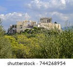 Small photo of Greece, Acropolis of Athens under blue cloudy sky, view from Pnyx hill