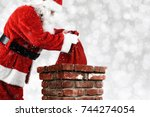 closeup of santa claus placing... | Shutterstock . vector #744274054