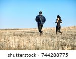 woman and man training in field ... | Shutterstock . vector #744288775