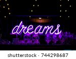 purple neon inscription dreams... | Shutterstock . vector #744298687