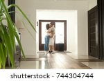 woman and little girl embracing ... | Shutterstock . vector #744304744