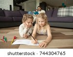 little boy and girl drawing... | Shutterstock . vector #744304765