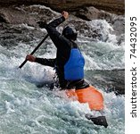 Kayaker Maneuvering At River...