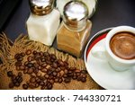 grains of coffee on burlap next ... | Shutterstock . vector #744330721