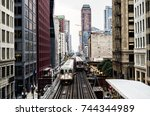 train on elevated tracks within ... | Shutterstock . vector #744344989