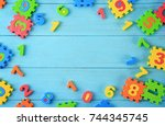 pieces of math puzzle scattered ...   Shutterstock . vector #744345745