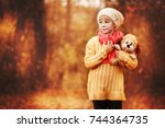 little girl in  yellow sweater ... | Shutterstock . vector #744364735