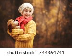 little girl in  yellow sweater ... | Shutterstock . vector #744364741