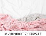 bedding with a pink knitted... | Shutterstock . vector #744369157