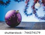 Violet Christmas Ball On A Blu...