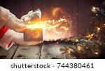 santa claus opens gift box ... | Shutterstock . vector #744380461