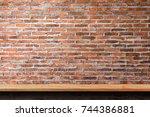 empty wooden shelf on old brick ... | Shutterstock . vector #744386881
