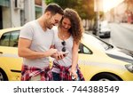 young stylish couple checking... | Shutterstock . vector #744388549
