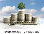 abstract tree growing from coin ...   Shutterstock . vector #744393109