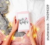 hello winter  female hands hold ... | Shutterstock . vector #744394339