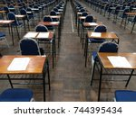 an empty exam hall with chair... | Shutterstock . vector #744395434