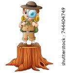 boy explorer with magnifying... | Shutterstock . vector #744404749