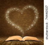 open old book. a star  heart... | Shutterstock . vector #74440537